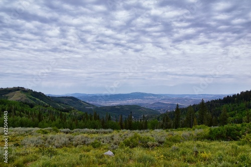 Park City, Empress Pass views of Panoramic Landscape along the Wasatch Front Rocky Mountains, Summer Forests and Cloudscape. Utah, United States.
