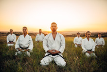 Karate Group Sitting On The Gr...