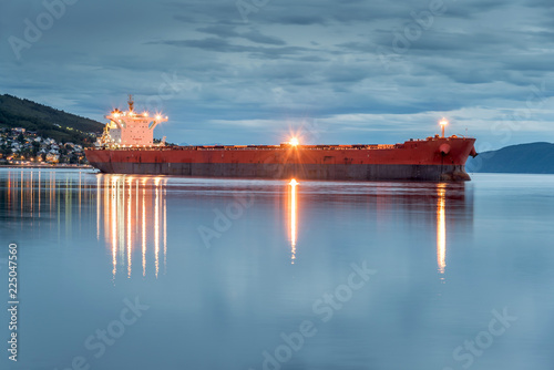 Fotografija View of a cargo ship anchoring in a port of Narvik to load iron ore, Norway
