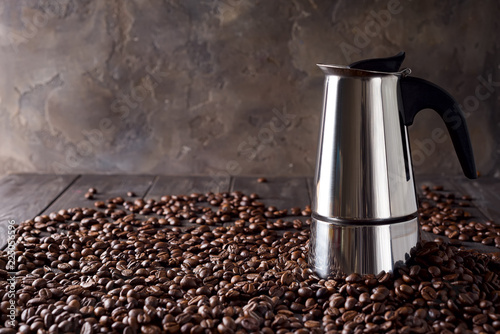 Wall Murals Cafe geyser coffee maker on the background of coffee grains on a dark wooden background, copy space