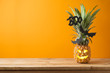 canvas print picture - Halloween holiday concept with jack o lantern pineapple on wooden table