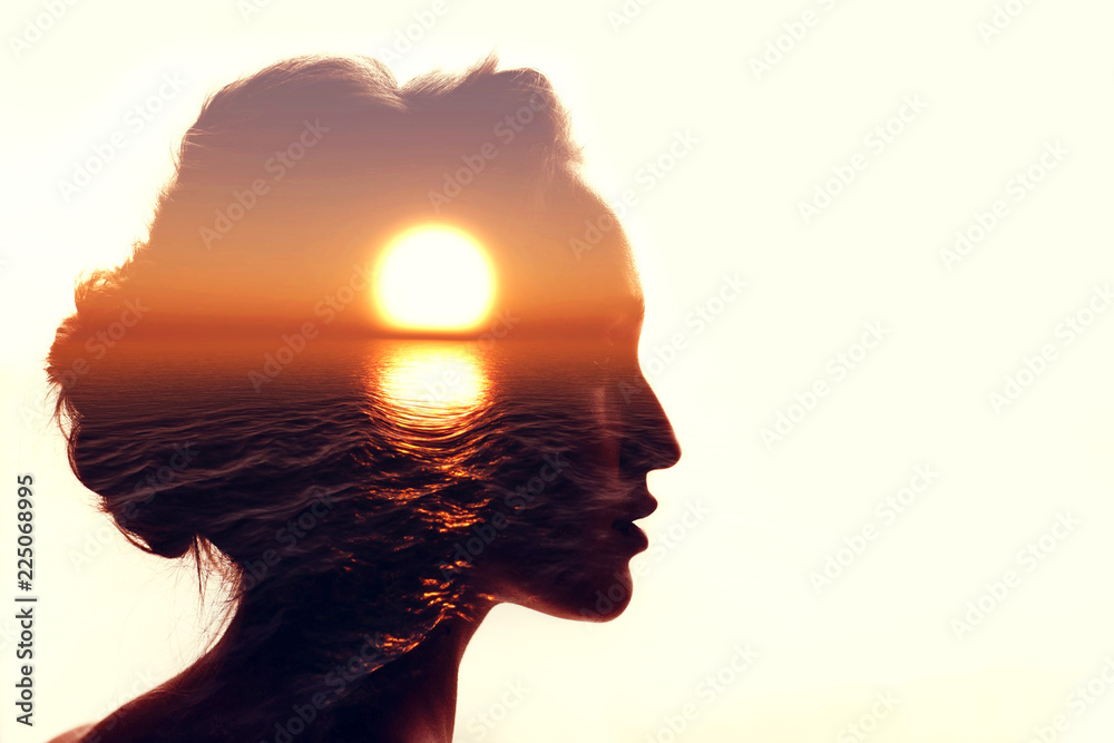 Fototapeta Psychology concept. Sunrise and woman silhouette. - obraz na płótnie