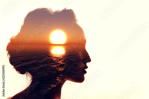 Psychology concept. Sunrise and woman silhouette. Fototapeta
