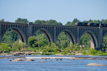 Train Traveling Across Arched ...