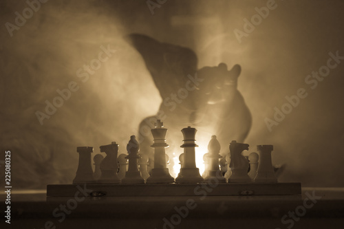 Man playing chess  Scary blurred silhouette of a person at