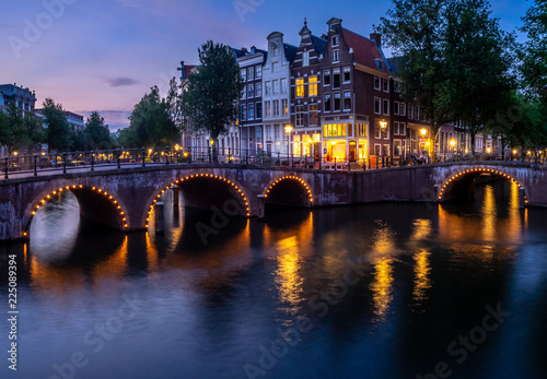 Poster Northern Europe Bridge over Keizersgracht - Emperor's canal in Amsterdam, The Netherlands at twilight.