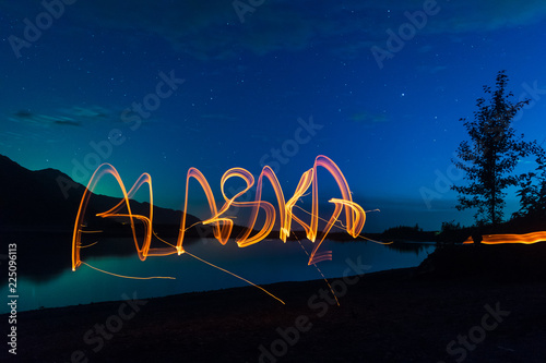 Keuken foto achterwand Verenigde Staten Light painted Alaska with blue evining sky with stars and faint northern lights
