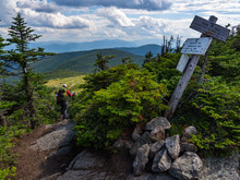 Hiker On Appalachian Trail In Maine, Lush Mountain Vista, Wooden Trail Sign