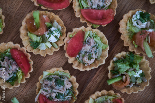Fotografie, Obraz  Delicious crispy tartlets or cake tarts  with cream cheese and vegetables, top v