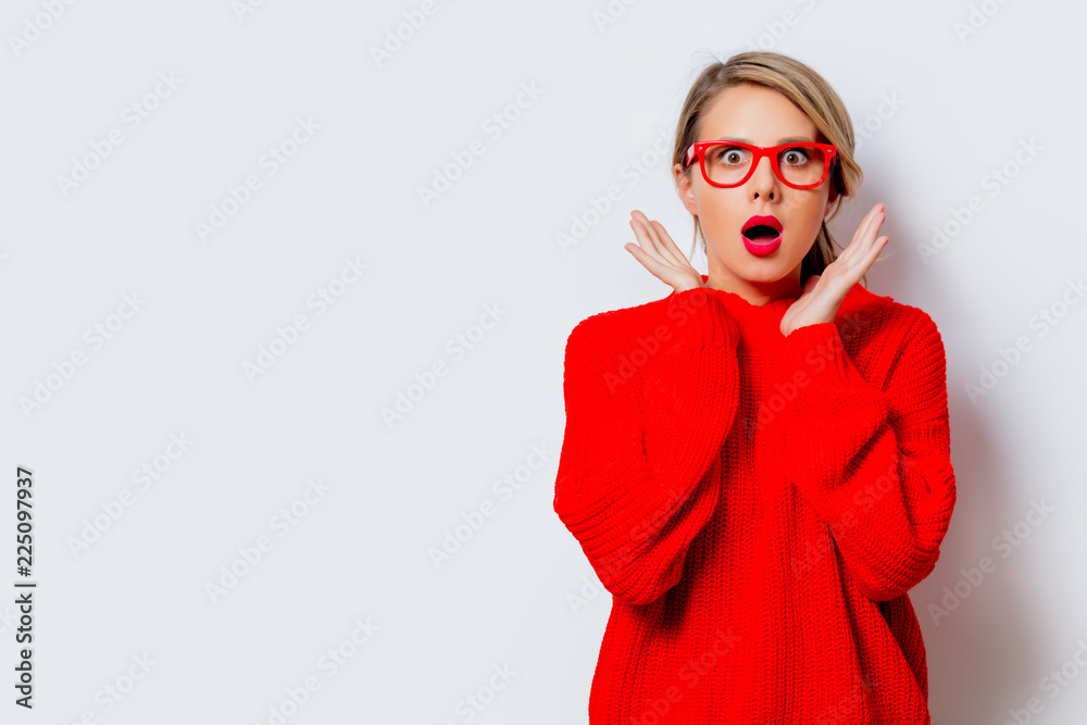 Fototapety, obrazy: Portrait of a beautiful white woman in red sweater on white background, isolated.