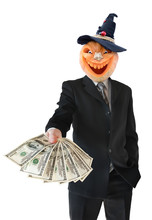 Portrait Of Jack Lantern  From Pumpkin In Black Business Suit. Jack Lantern Keeps Money In His Hands. Pumpkin For Halloween Carved In The Shape Of A Smile.
