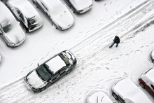Snow Covered Street Wit Car And People