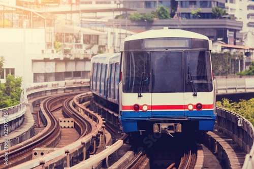 Electric skytrain is running in downtown of Bangkok metropolitan region.