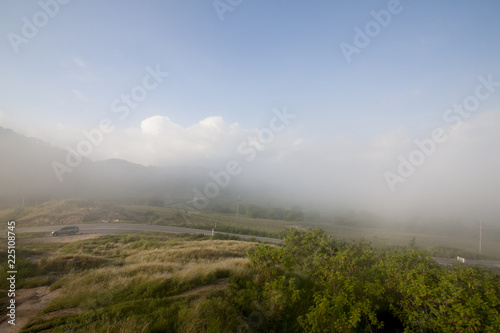 Spoed Foto op Canvas Blauwe hemel Landscape nature of meadows in the mountains with fog in the morning at Khao Phu Don Rayong Thailand.