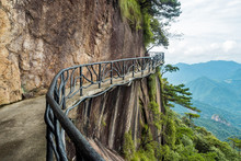 Wooden Walkway On The Cliff Face With Metal Guard Rails