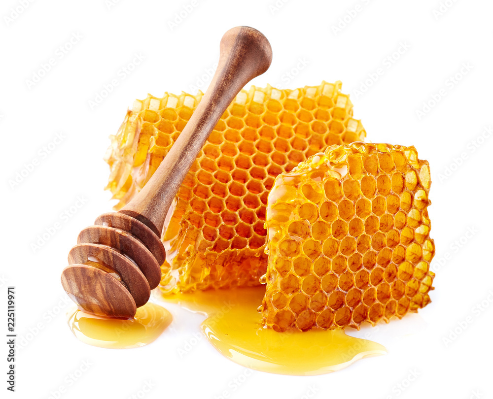 Honeycomb with honey on white background