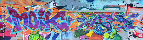 Poster Graffiti Fragment of graffiti drawings. The old wall decorated with paint stains in the style of street art culture. Colored background texture in purple tones