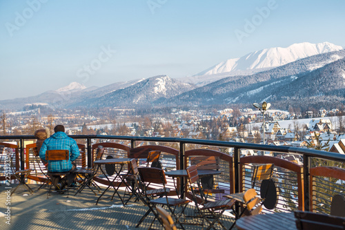 Outdoor mountain cafe in winter season, Poland, ski resort Zakopane, mountains of Polish Tatras