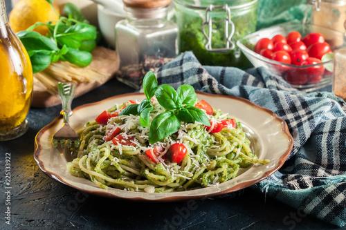 Obraz Vegetarian pasta spaghetti with basil pesto and cherry tomatoes - fototapety do salonu