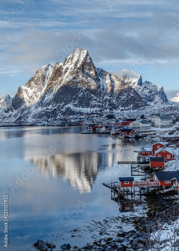 Deurstickers Noord Europa Lofoten Islands, Norway. Winter mountains and fjord with rorbu - typical red fishing lodge, reflection in water. Blue hours. Vertical landscape. Travel Norway.