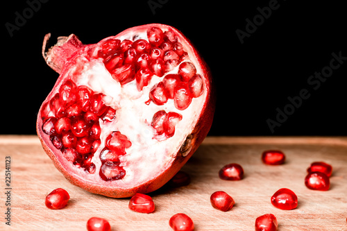 Foto op Aluminium Vruchten Red pomegranate fruit seed. Shallow depth of field. Retro vintage effect