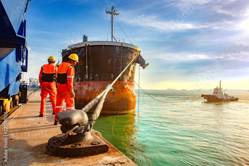 Fototapeta ship vessel is on leaving departure from the port terminal after completion of l