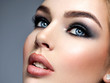 canvas print picture Closeup face of a beautiful girl with  makeup in style smoky eyes.