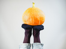 Ripe Pumpkin, Men's Legs, Bright, Colorful, Funny Socks. White Background, Isolated, Close-up. Holidays, Fashion, Elegance, Fun