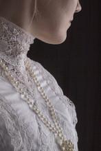 Edwardian Woman In White Blouse