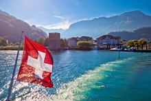 Lake Luzern Boat Flowing From Stansstad Village With Swiss Flag