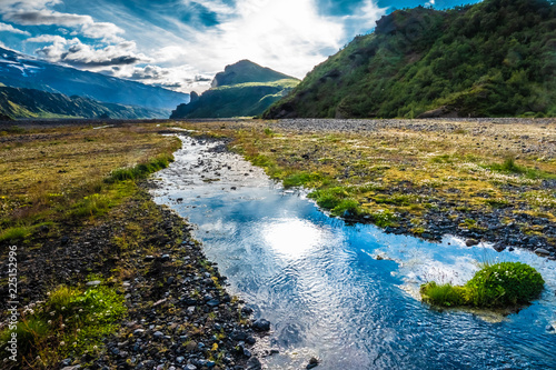 Glacial river in the dramatically beautiful and surreal landscapes of Thorsmork valley in the Highlands of Iceland at southern end of the famous Laugavegur hiking trail Canvas-taulu