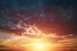 Creative background. Beautiful, atmospheric sunset in the sky. Red, yellow rays of the setting sun. copy space