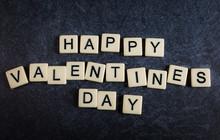 Scrabble Letter Tiles On Black...