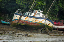 Old Boat At Rest On Mud