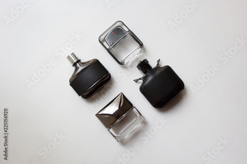 Fototapeta Four glass perfume bottles isolated on white background from a high angle view obraz