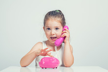 Beautiful Cute Little Girl Talking On Toy Telephone With Excited Expression