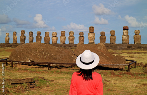 Spoed Foto op Canvas Zuid-Amerika land One female tourist impressed by the ruins of Moai statues at Ahu Tongariki on Easter Island, Chile, South America