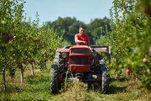 Senior Farmer Driving His Tractor