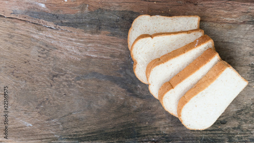 Valokuva  Bread food on the wood chopping board for sale