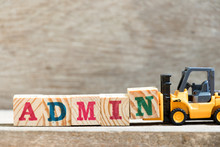 Toy Forklift Hold Letter Block N In Word Admin On Wood Background