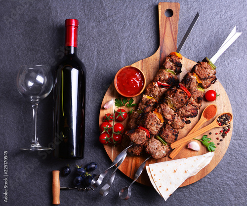 Wine and kebab with spices and vegetables