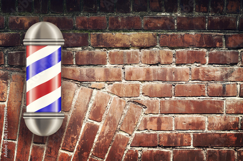 Barber pole on the background of the old brick wall Fototapeta