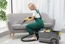 Female Janitor Removing Dirt F...