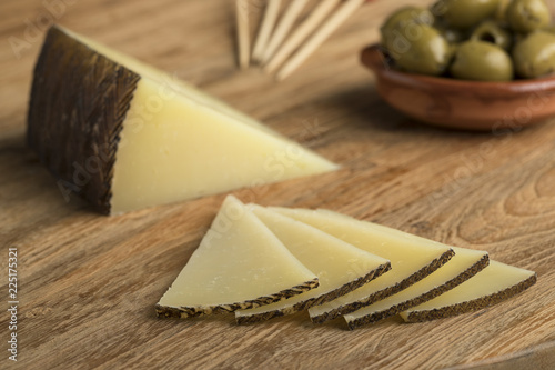 Slices of Spanish Manchego cheese