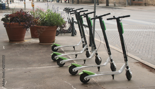 Vászonkép Dockless Electric Scooters on the Sidewalk