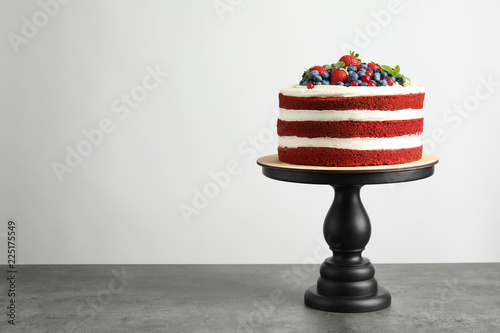 Fototapeta Delicious homemade red velvet cake and space for text on light background obraz