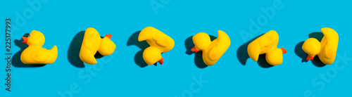 Collection of yellow rubber ducks on a blue background Tableau sur Toile