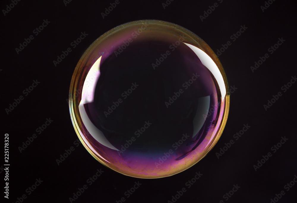 Fototapeta Beautiful translucent soap bubble on dark background