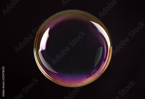 Beautiful translucent soap bubble on dark background Canvas Print