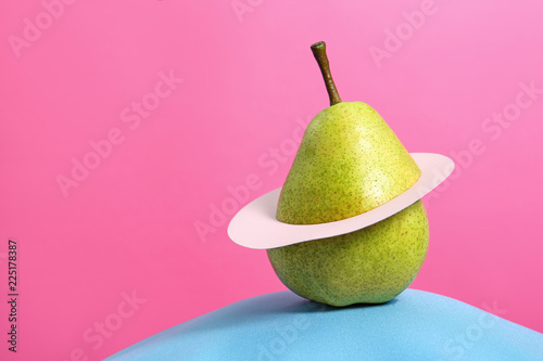 Creative composition with fresh ripe pear and space for text against color background